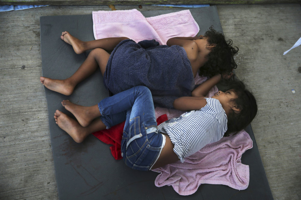 In this July 17, 2019, file photo, migrant children sleep on a mattress on the floor of the AMAR migrant shelter in Nuevo Laredo, Mexico. (Marco Ugarte/AP)