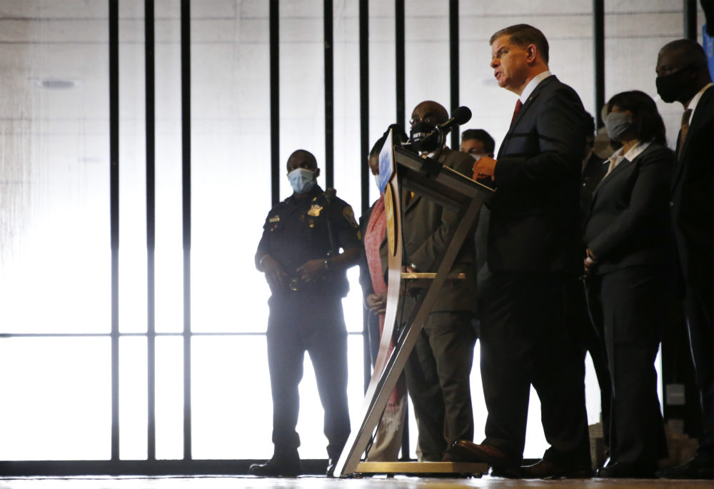 Mayor Marty Walsh spoke at a press conference flanked by members of the Boston Police Reform Task Force as he announced a plan for a slate of reforms to the Boston Police Department. (Jessica Rinaldi/Globe Staff/Pool)