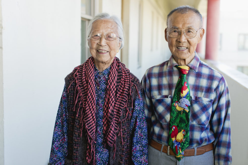 """A couple featured in """"Chinatown Pretty: Fashion and Wisdom from Chinatown's Most Stylish Seniors,"""" by Andria Lo and Valerie Luu, published by Chronicle Books 2020. (Courtesy)"""