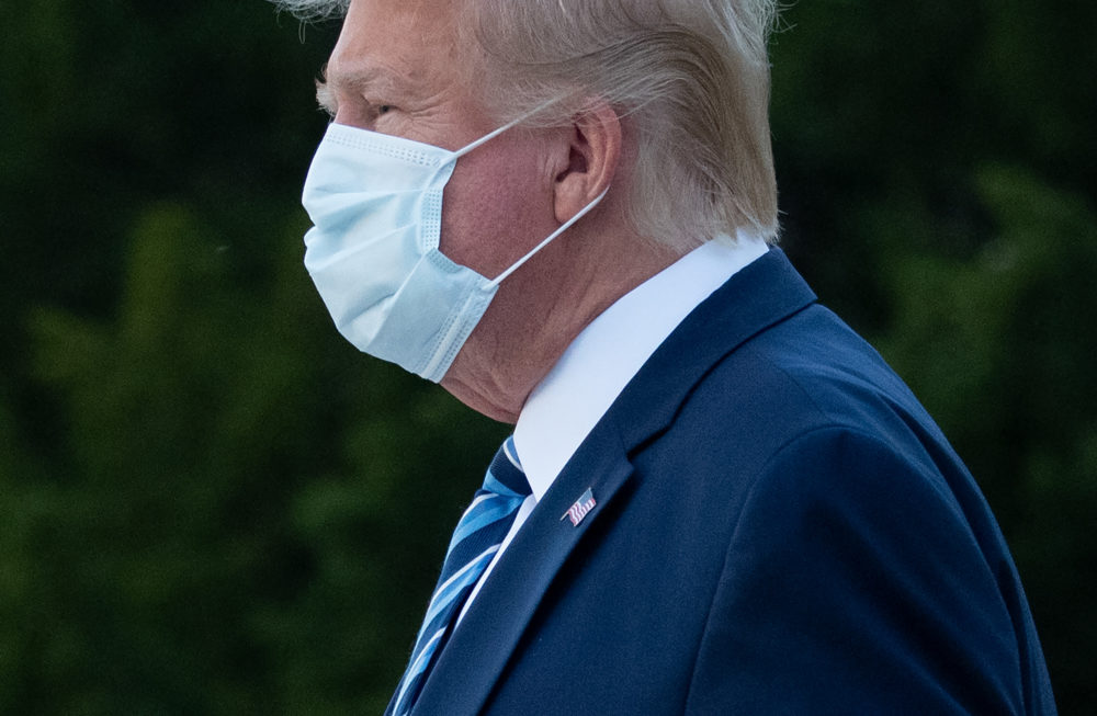 President Donald Trump leaves Walter Reed Medical Center in Bethesda, Maryland heading towards Marine One on October 5, 2020, to return to the White House after being discharged. (Photo by SAUL LOEB/AFP via Getty Images)