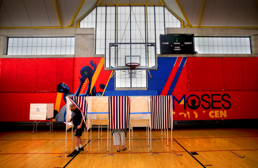 A voter leaves the booth inside the Moses Youth Center, the Precinct 2, Ward 3 polling place in Central Square in Cambridge on Sept. 1, 2020. (Lane Turner/The Boston Globe via Getty Images)