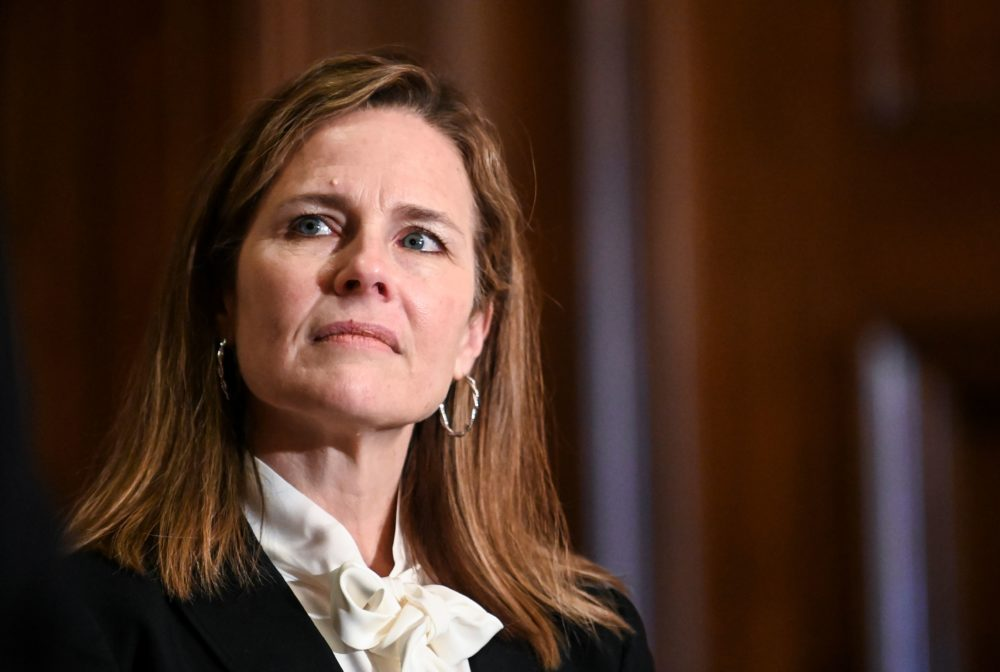 Judge Amy Coney Barrett, President Trump's nominee for the U.S. Supreme Court, looks on during a meeting with Sen. Kevin Cramer (R-ND) on Capitol Hill in Washington, D.C. on Oct. 1, 2020. (Erin Scott / Pool / AFP via Getty Images)