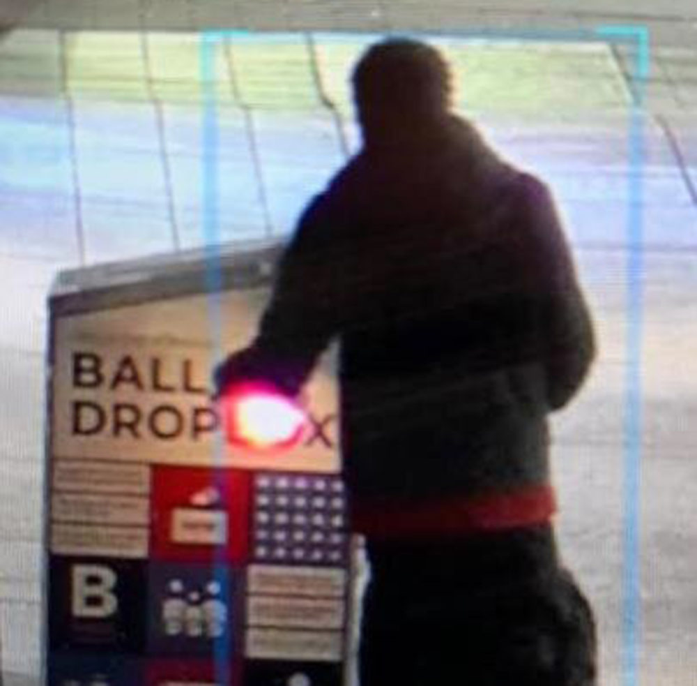 A surveillance image, released by Boston police, of a person they are attempting to identify as part of the investigation of the ballot box fire. (Courtesy Boston Police Department)