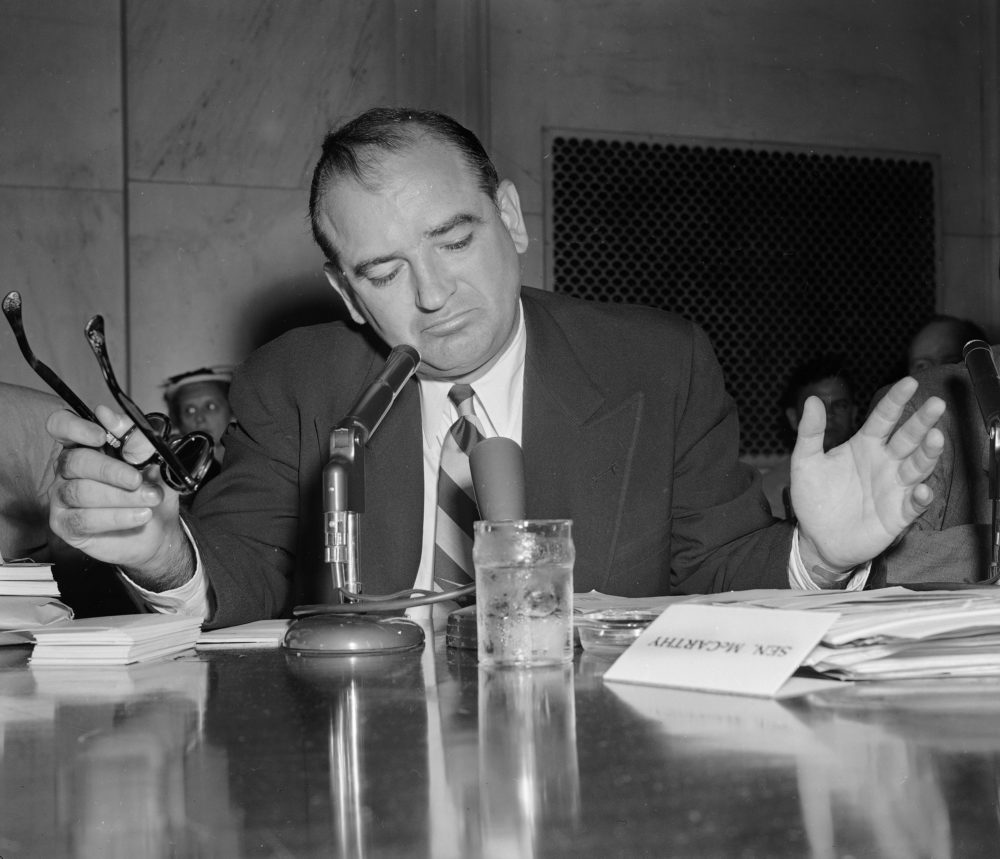 Sen. Joe McCarthy gestures as he indicates he is not impressed with an answer by Army Secretary Robert Stevens during a hearing, May 3, 1954. (AP Photo)