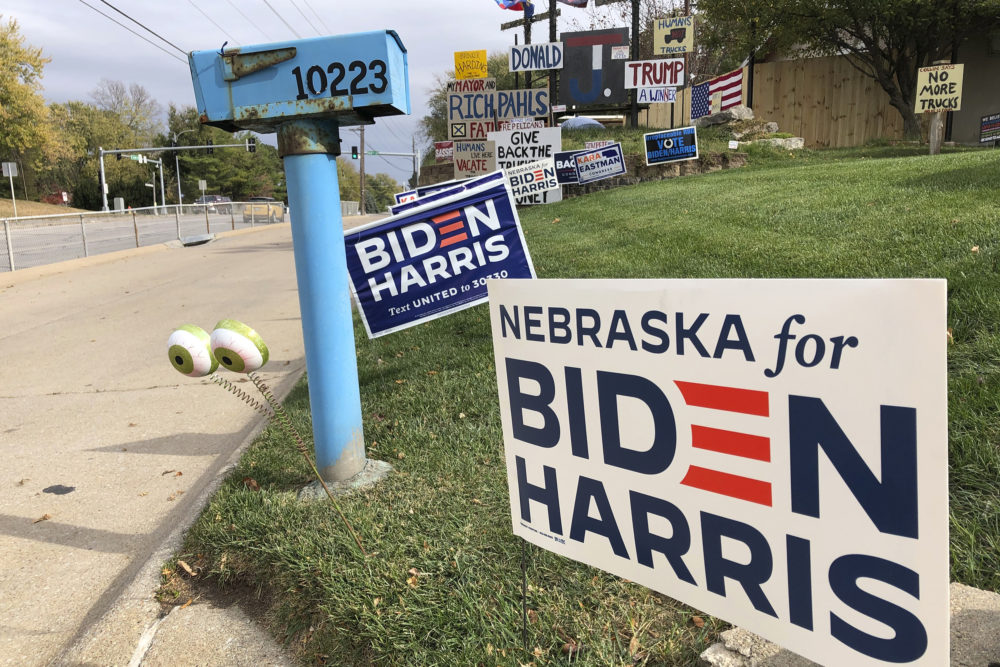 A Joe Biden presidential campaign sign greets passersby in a leafy neighborhood of Omaha, Neb., on Oct. 19. (Grant Schulte/AP)