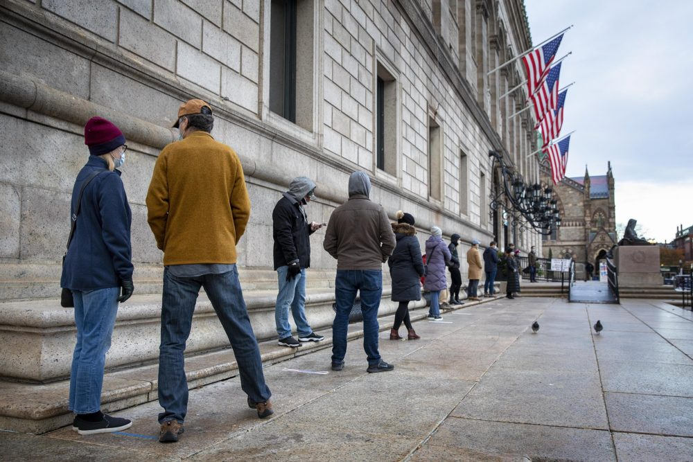Voters line up to vote at the Boston Public Library on Election Day 2020. (Robin Lubbock/WBUR)