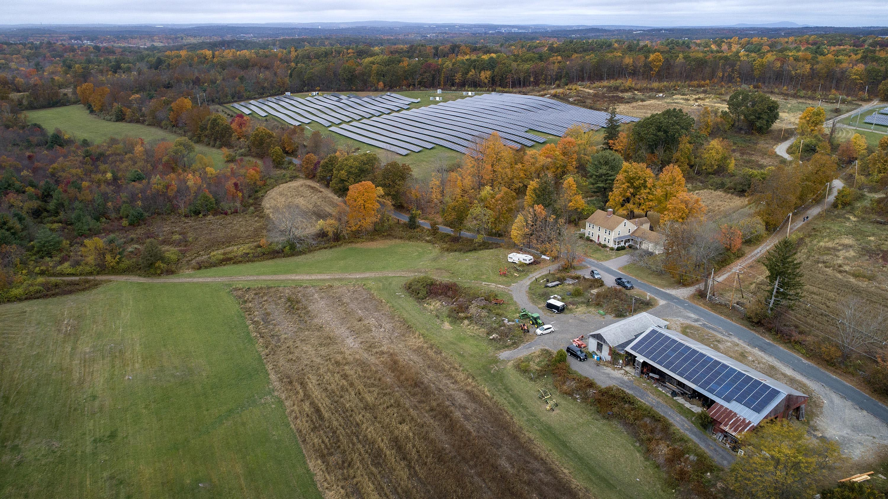 Farming the sun, Knowlton Farm in Grafton has solar panels on its barn roof, and in fields nearby. (Robin Lubbock/WBUR)