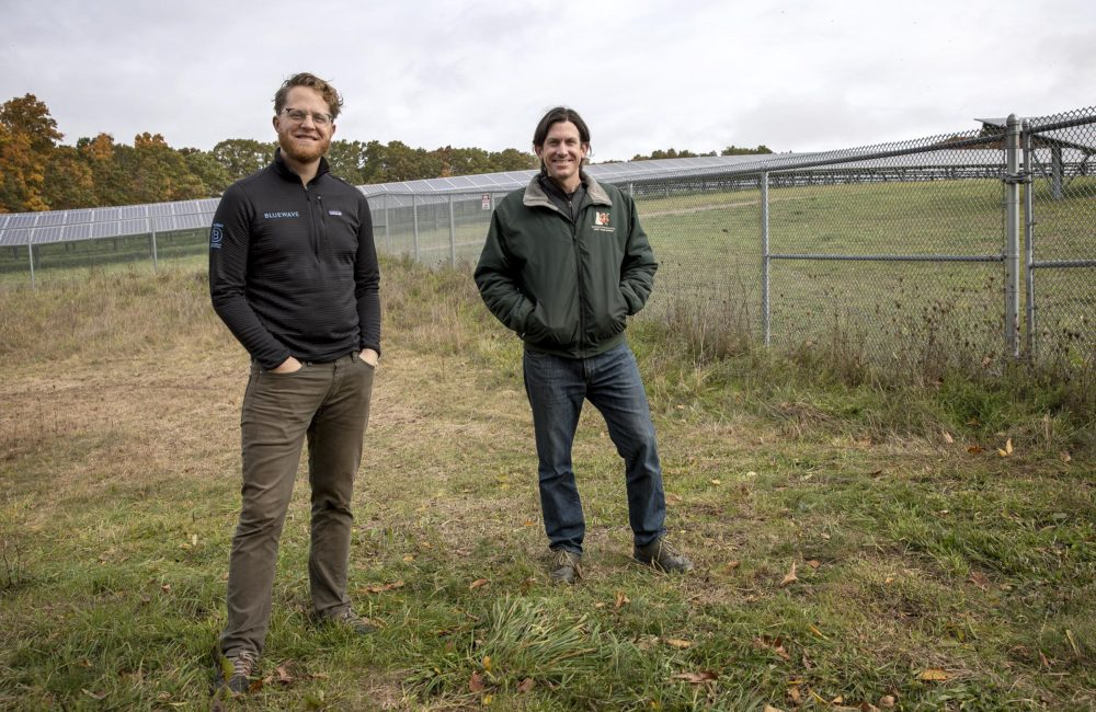 Drew Pierson of Bluewave and Iain Ward of Solar Agricultural Services, at Knowlton Farm. (Robin Lubbock/WBUR)