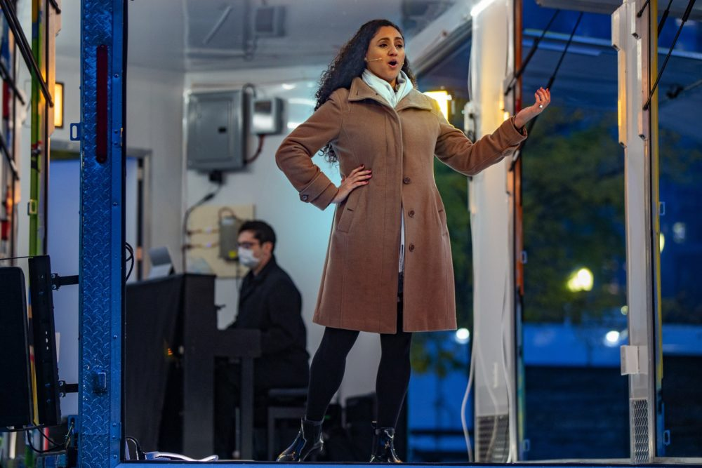 """Zaray Rodriguez and Brendon Shapiro performs """"Habanera"""" from Bizet's """"Carmen"""" in the Boston Lyric Opera's Street Stage, on the Rose Kennedy Greenway. (Jesse Costa/WBUR)"""