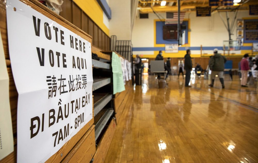 A voting sign at East Boston High School polling station. (Robin Lubbock/WBUR)