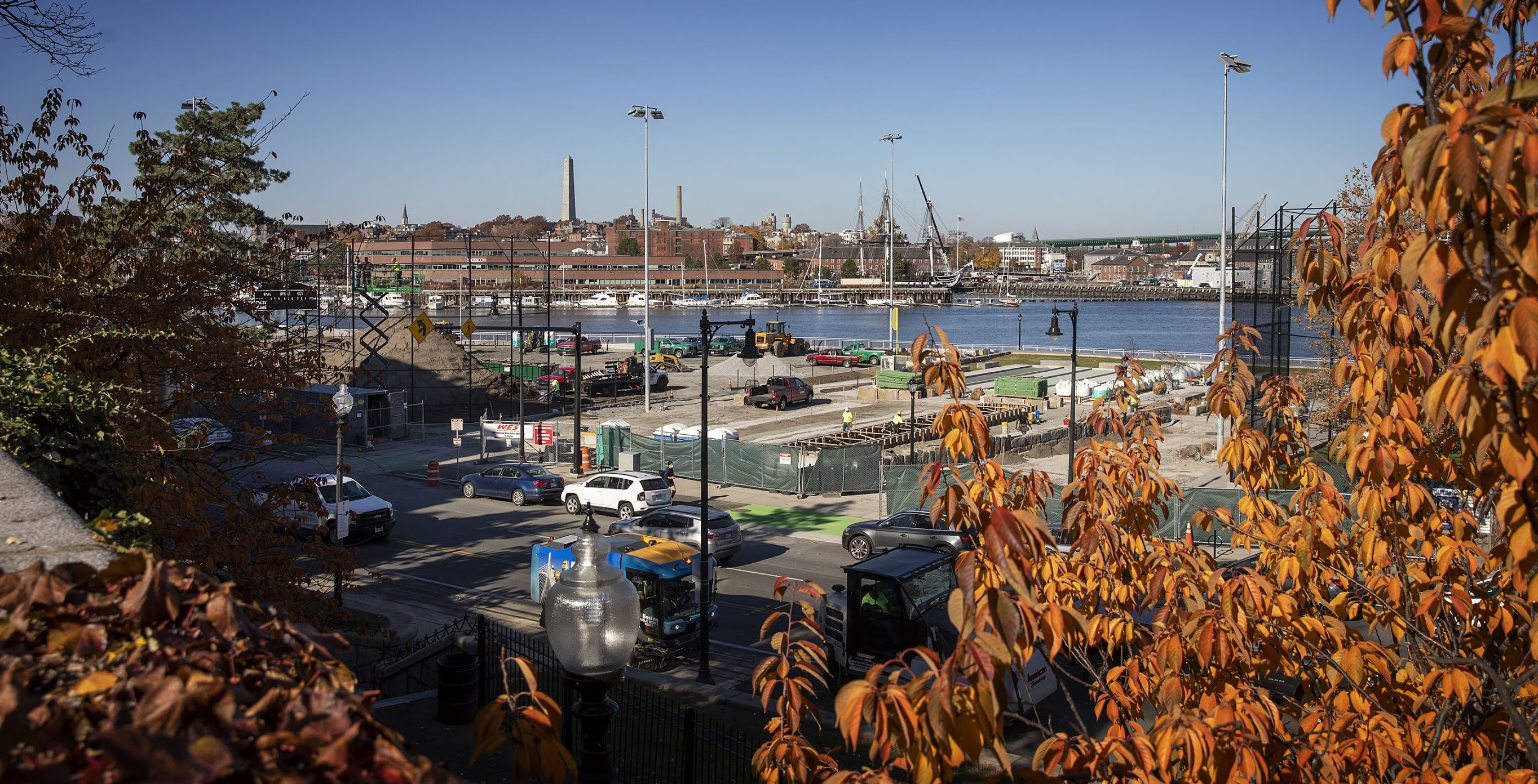 The view from Langone Park under construction, looking across the harbor to Bunker Hill and the USS Constitution. (Robin Lubbock/WBUR)