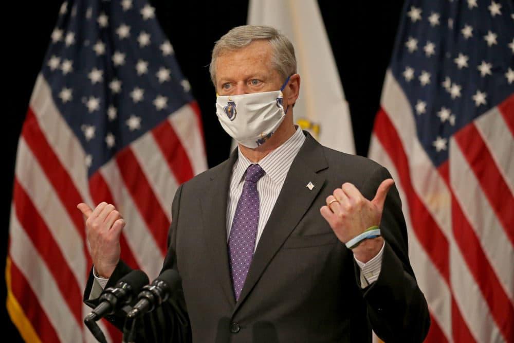 Gov. Charlie Baker speaks while wearing a mask bearing the Massachusetts seal. (Stuart Cahill/MediaNews Group/Boston Herald)