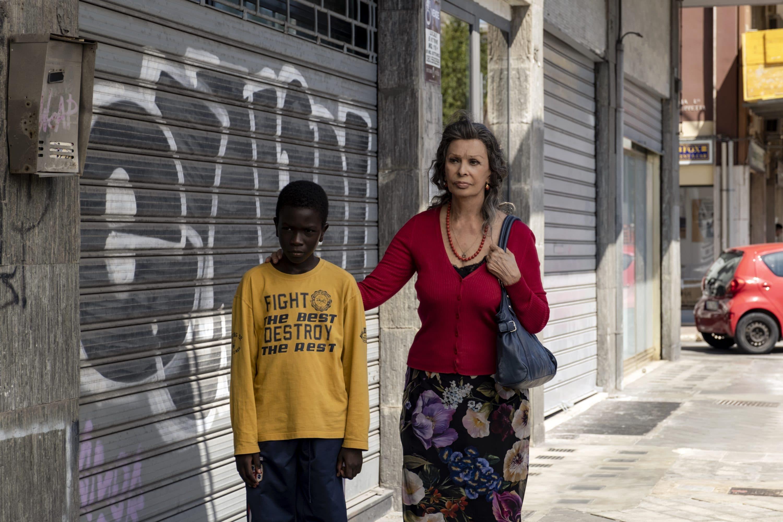 "Ibrahima Gueye (left) and Sophia Loren in ""The Life Ahead."" (Courtesy Netflix)"