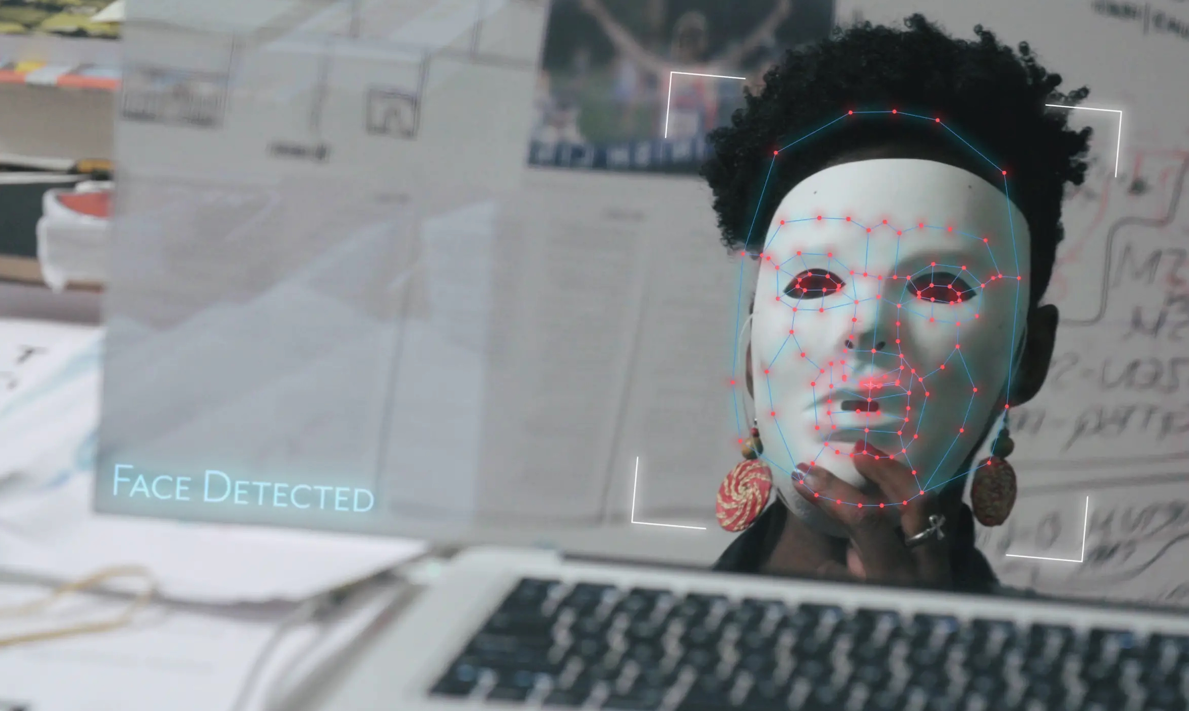 Joy Buolamwini wearing a mask to test facial recognition software. (Courtesy 7th Empire Media)