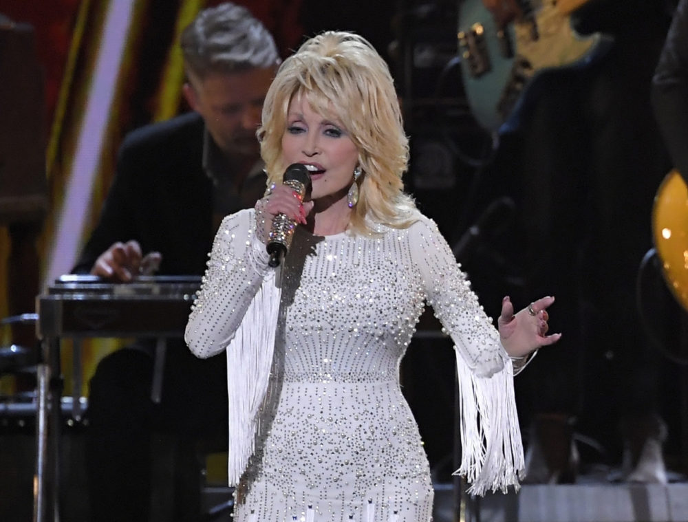 In this Nov. 13, 2019 file photo, Dolly Parton performs at the 53rd annual CMA Awards in Nashville, Tenn. Parton's $1 million gift to Nashville's Vanderbilt University Medical Center helped researchers develop Moderna's experimental coronavirus vaccine, announced this week. (AP Photo/Mark J. Terrill, File)