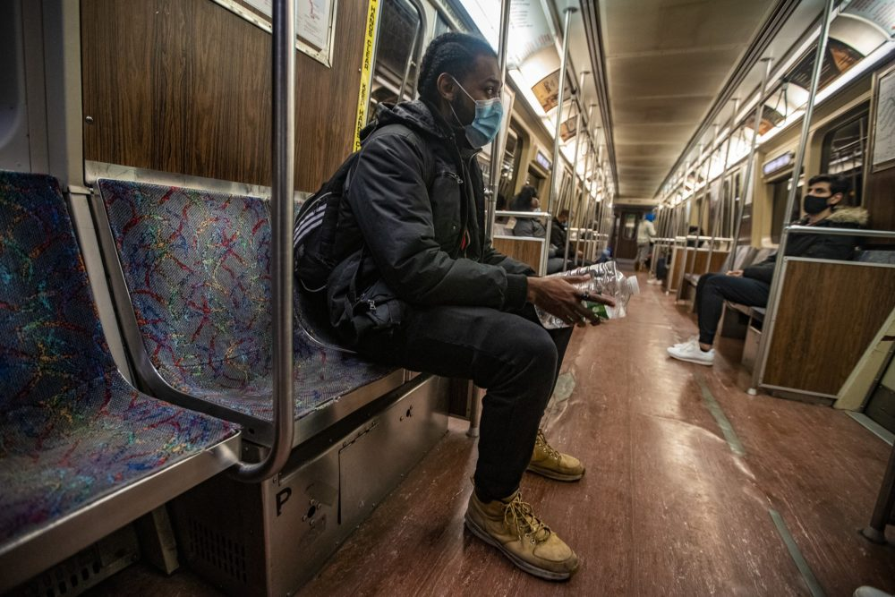 Josh Knight commutes on the Orange Line — and a bus and shuttle — to the Charlestown YMCA. (Jesse Costa/WBUR)