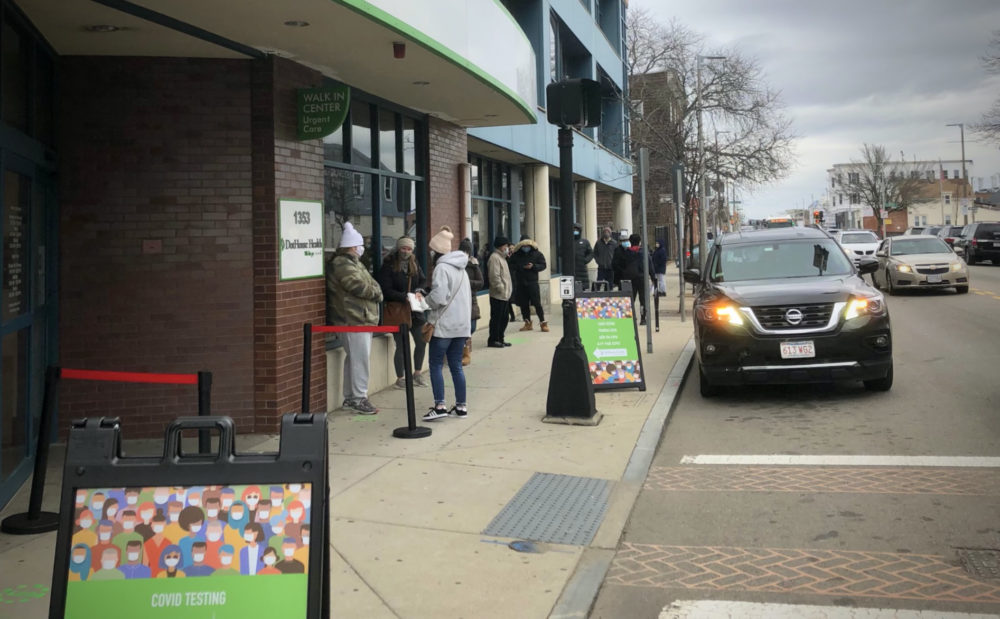 The start of the long line at DotHouse Health on Wednesday afternoon for coronavirus tests. (Carey Goldberg/WBUR)