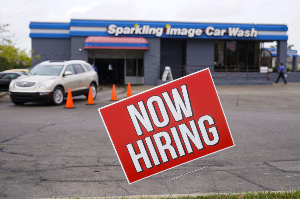 In this Sept. 2, 2020, file photo, a help wanted sign is displayed at car wash in Indianapolis. (Michael Conroy/AP File)