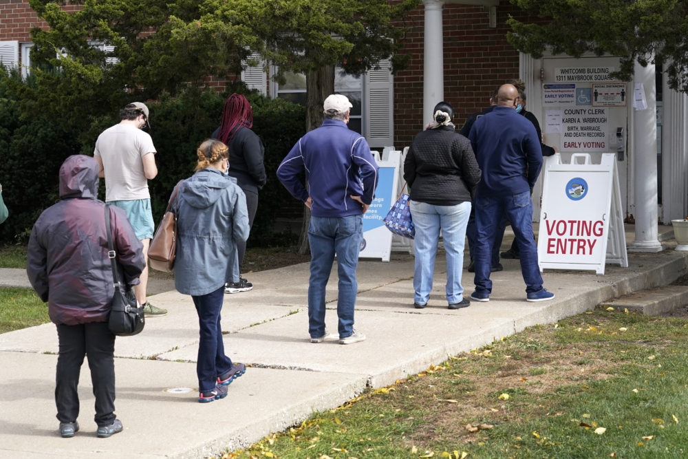 Cook County, Ill., residents wait in line for early voting and other county services. Oct. 13, 2020, at a county courthouse in Maywood, Ill. (Charles Rex Arbogast/AP)