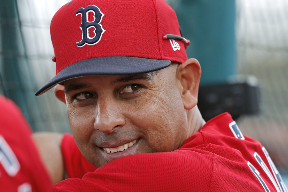 In this Feb. 18, 2019, file photo, Boston Red Sox manager Alex Cora smiles from behind the batting cage during their first full squad workout at their spring training baseball facility in Ft. Myers, Fla. (Gerald Herbert/AP File)