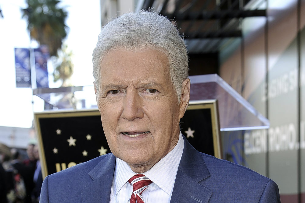 "Alex Trebek, host of ""Jeopardy!"" attends a ceremony honoring the show's executive producer Harry Friedman with a star on the Hollywood Walk of Fame in Los Angeles, in this Friday, Nov. 1, 2019, file photo. ""Jeopardy!"" host Alex Trebek died Sunday , Nov. 8, 2020, after battling pancreatic cancer for nearly two years. Trebek died at home with family and friends surrounding him, ""Jeopardy!"" studio Sony said in a statement. Trebek presided over the beloved quiz show for more than 30 years. (Richard Shotwell/Invision/AP)"