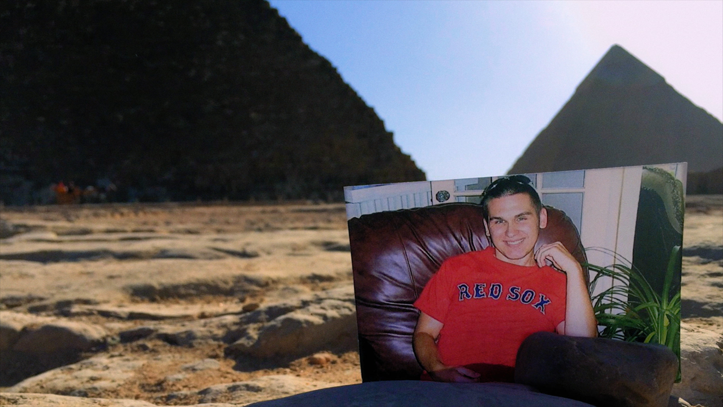 A photograph of CJ in front of the Pyramid of Giza. (Courtesy Spark Media)