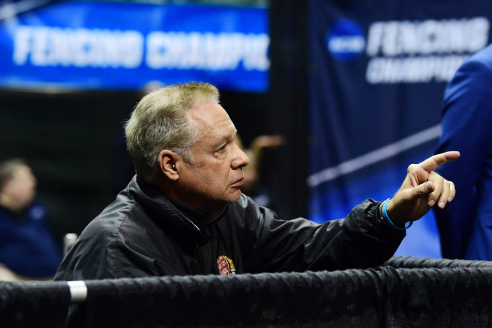 Head coach Peter Brand talks to an athlete in the Saber semi finals during the Division I Women's Fencing Championship held at The Wolstein Center on the Cleveland State University campus on March 24, 2019 in Cleveland, Ohio. (Photo by Jason Miller/NCAA Photos via Getty Images)