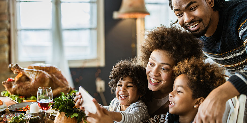 Keep your Thanksgiving gatherings to your household only this year, says Dr. Asaf Bitton, public health expert and physician at Brigham and Women's Hospital. (Getty Images)