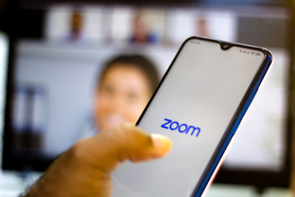 In this photo illustration, a Zoom logo is seen displayed on a smartphone. (Photo illustration by Rafael Henrique/SOPA Images/LightRocket via Getty Images)