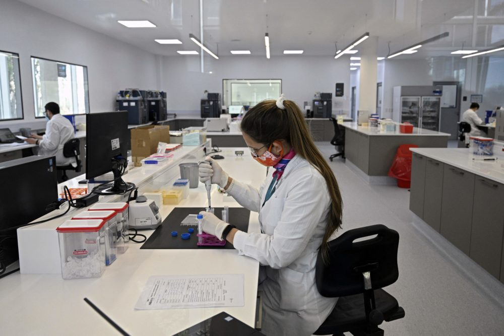Scientists work at the mAbxience biosimilar monoclonal antibody laboratory plant in Garin, Buenos Aires province, on August 14, 2020, where an experimental coronavirus vaccine will be produced for Latin America. - Argentina will manufacture while Mexico will pack and distribute in Latin America, except of Brazil, the vaccine against COVID-19 developed by the University of Oxford and the AstraZeneca laboratory. (Juan Mabromata/AFP via Getty Images)