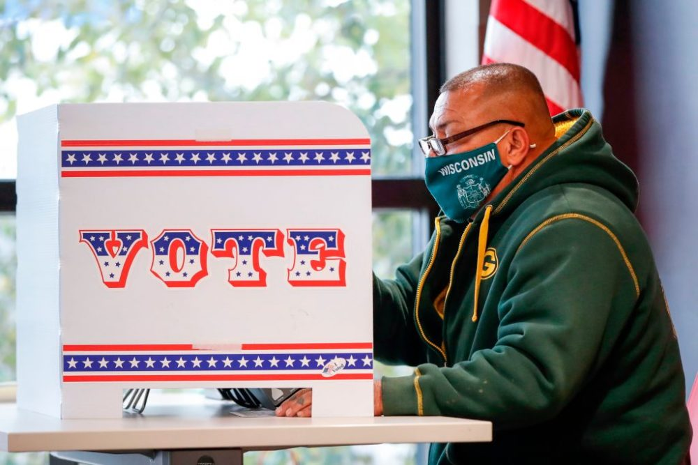 A man casts his ballot at Tippecanoe Library on the first day of in-person early voting on October 20, 2020 in Milwaukee, Wisconsin.  (Kamil Krzaczynski/AFP via Getty Images)