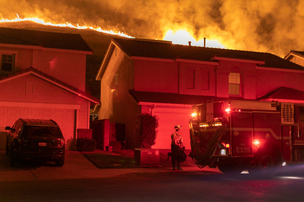 Flames come close to houses during the Blue Ridge Fire on October 27, 2020 in Chino Hills, California. (David McNew/Getty Images)