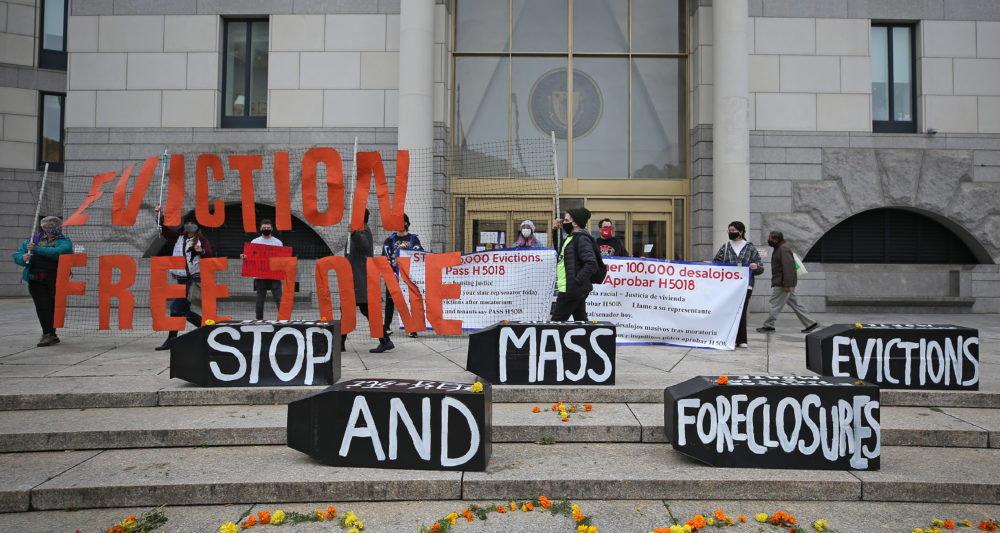 Demonstrators display signs calling for an end to evictions and foreclosures during a rally at Boston Housing Court outside the Edward W. Brooke Courthouse in Boston on Oct. 29, 2020. (David L. Ryan/The Boston Globe via Getty Images)