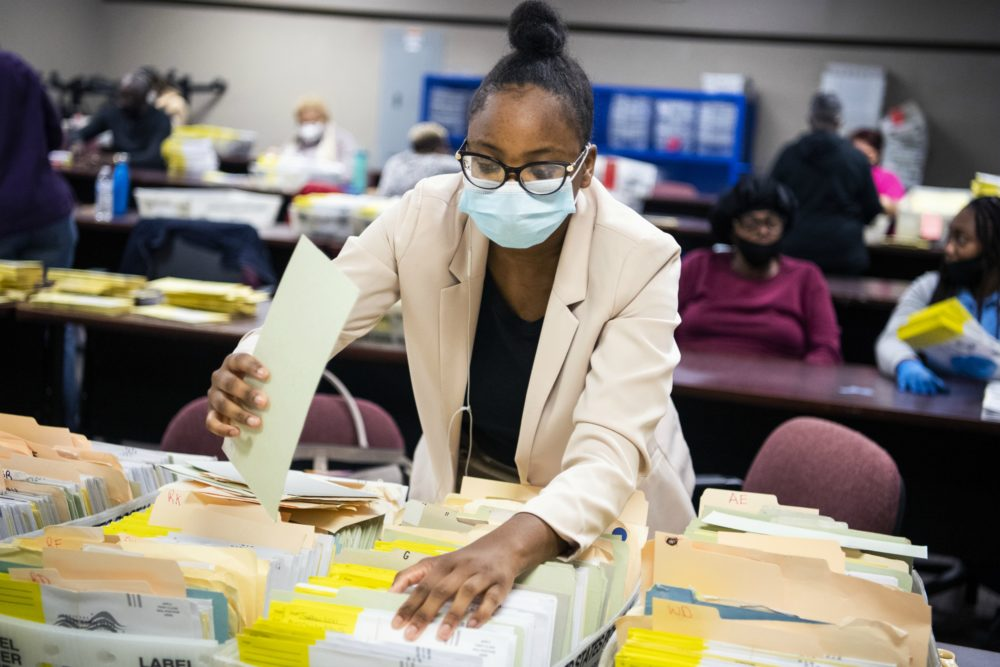 Election workers sort ballots at the Dekalb County Voter Registration and Elections Office in Decatur, Ga., on Monday, November 2, 2020. (Tom Williams/CQ Roll Call)