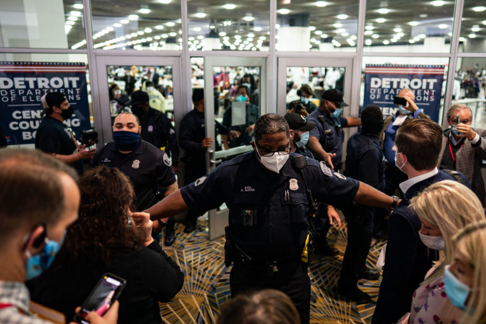 Election challengers demand to enter to observe the absentee ballots counting but were denied after the room reached capacity during the 2020 general election in Detroit, Michigan on Wednesday, Nov. 4, 2020. (Salwan Georges/The Washington Post via Getty Images)