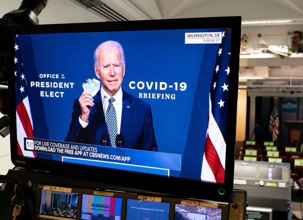 President-elect Joe Biden is shown speaking on a monitor about COVID-19 in the briefing room of the White House on November 9, 2020, in Washington, D.C. (Joshua Roberts/Getty Images)