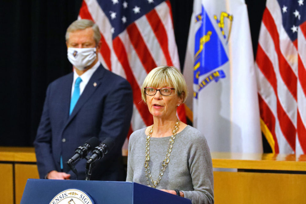 Secretary of Health and Human Services Marylou Sudders, along with Gov. Charlie Baker, speaks during a press conference at the Massachusetts State House in Boston on Nov. 18, 2020. (Photo by Pat Greenhouse/The Boston Globe via Getty Images)