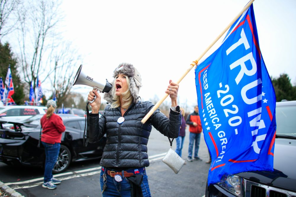 A woman shouts slogans as Trump Supporters gather during a car rally named as Stop the Steal on November 22, 2020 in Long Valley, New Jersey. (KENA BETANCUR/AFP via Getty Images)