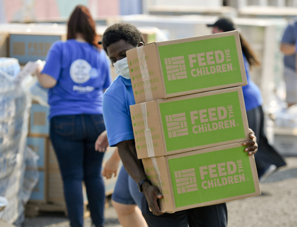 Quinton Robinson carries a stack of boxes from Feed The Children.At the Hope Rescue Mission in Reading, PA on August 27, 2020 where a food distribution was held from Feed the Children, in cooperation with Price Rite Marketplace, and Hope Rescue Mission. Families received boxes of food, personal care items, and two backpacks with school supplies. The distribution was done to meet the heightened need during the COVID-19 outbreak. (Ben Hasty/MediaNews Group/Reading Eagle via Getty Images)