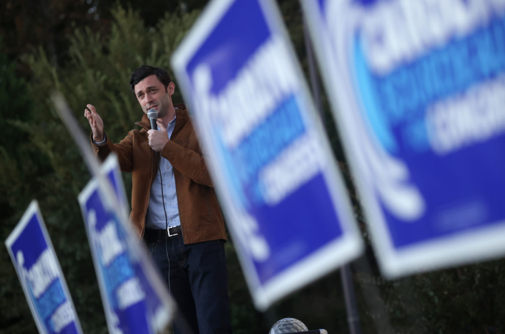 """Democratic U.S. Senate candidate Jon Ossoff speaks during a """"Don't Boo, Early Vote"""" event outside of Pleasant Hill Baptist Church on November 30, 2020 in Lawrenceville, Georgia. (Justin Sullivan/Getty Images)"""