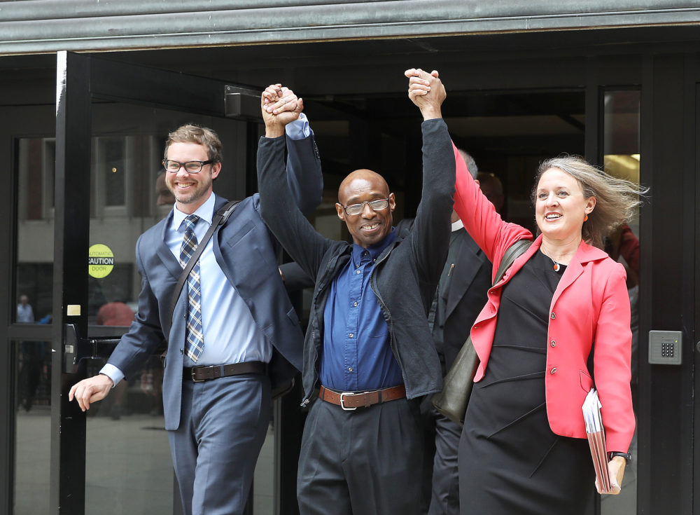 Frederick Clay, center, walks out of the Suffolk Superior Courthouse in Boston as a free man in August 2017. He is flanked by defense attorneys Jeffrey Harris and Lisa Kavanaugh. (Pat Greenhouse/The Boston Globe via Getty Images)