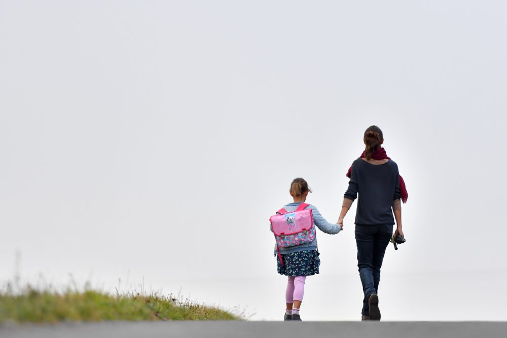 A girls walks to her primary school with her mother on the first day of the new school year in Vertou, western France, on Sept. 4, 2017. (Loic Venance/AFP Via Getty Images)