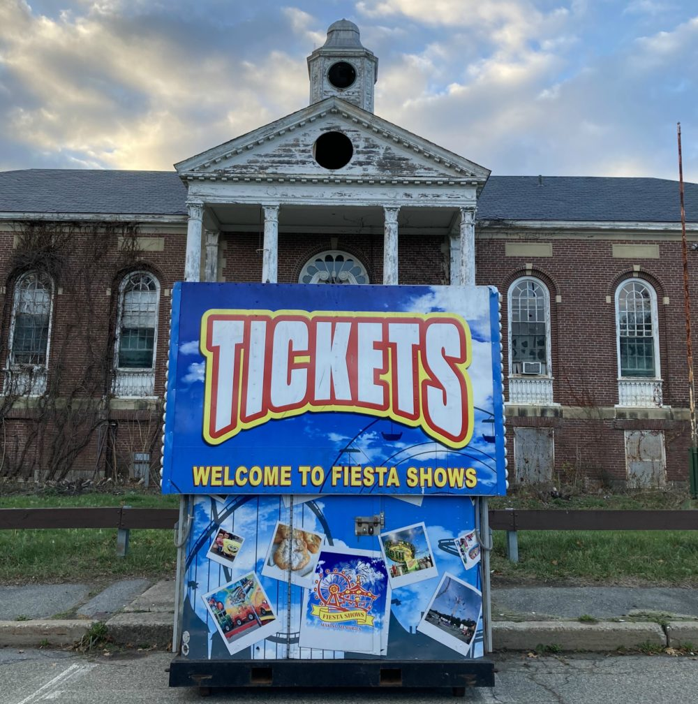 A ticket booth for a Lions Club fundraiser in front of the vandalized administration building of the Walter E. Fernald Developmental Center in Waltham. (Courtesy)