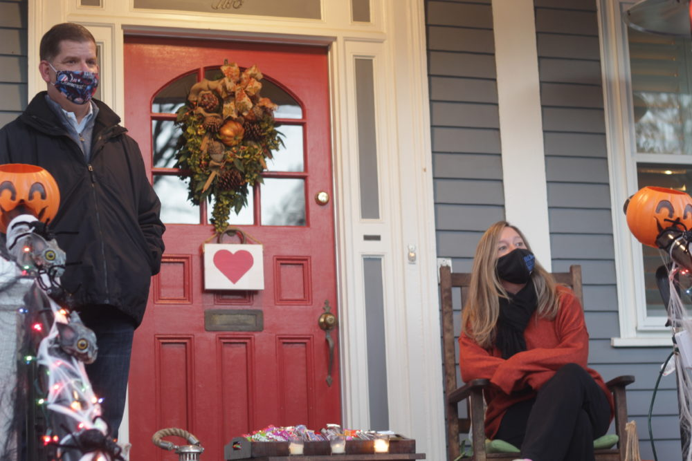 Boston Mayor Marty Walsh and his longtime girlfriend, Lorie Higgins, wait for trick-or-treaters at their Lower Mills, Dorchester, home. (Quincy Walters/WBUR)