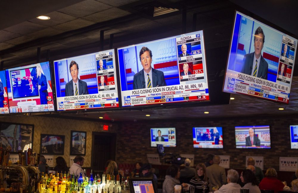 Televisions play election coverage at a watch party for President Donald Trump in Weymouth. (Joe Difazio for WBUR)