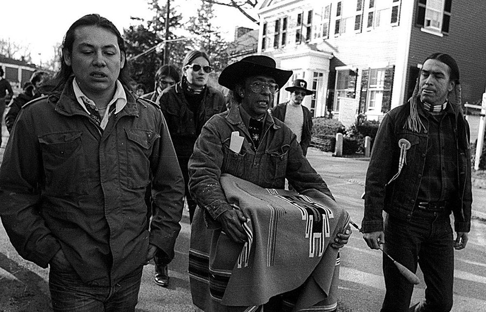 Kisha James' grandfather (center) carrying a box. In the box are the Wampanoag human remains he and other National Day of Mourning protesters liberated from the Pilgrim Museum in 1974. (Courtesy)