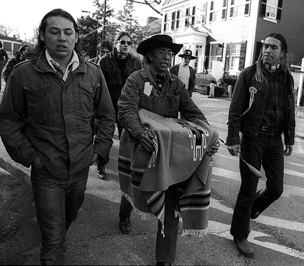 Kisha James' grandfather (center) carrying a box. In the box are the Wampanoag human remains he and other National Day of Mourning protesters liberated from the Pilgrim Museum in 1974. (Courtesy of guest)
