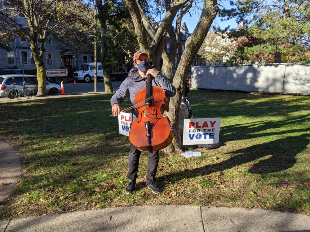 Cellist Mike Block performs outside of a polling place in Somerville on election day 2020. (Jamie Bologna/WBUR)
