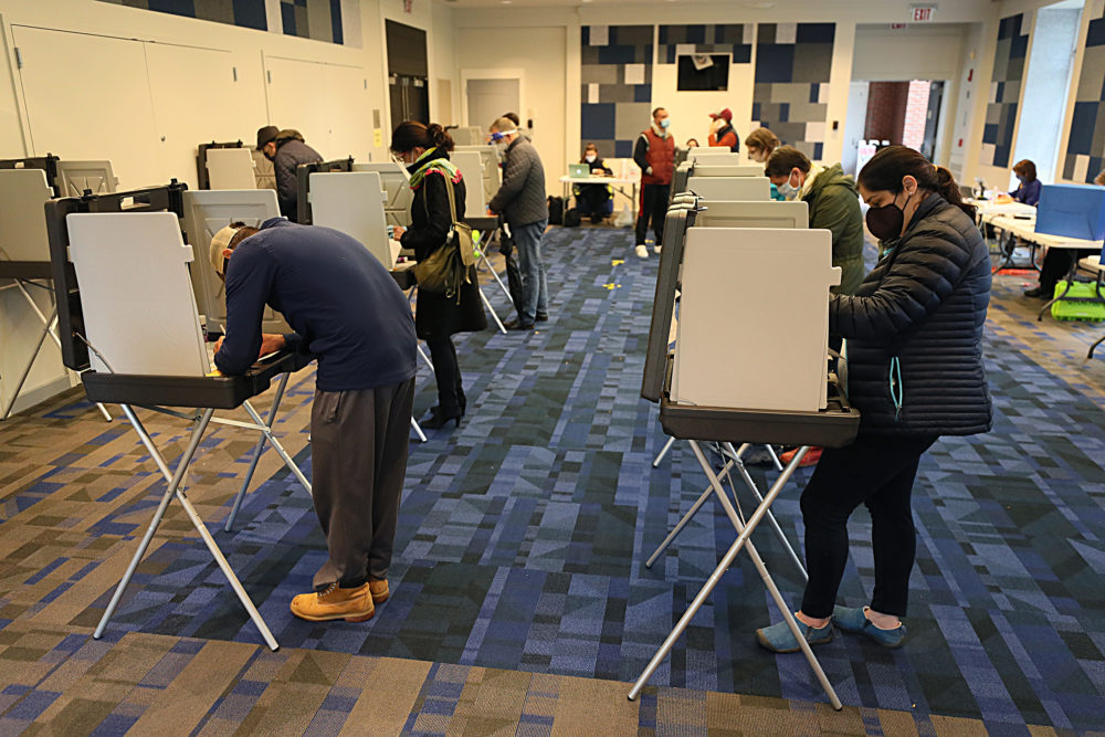 Early voting at the Newton Free Library for early in-person voting on Oct. 28. (Suzanne Kreiter/The Boston Globe via Getty Images)