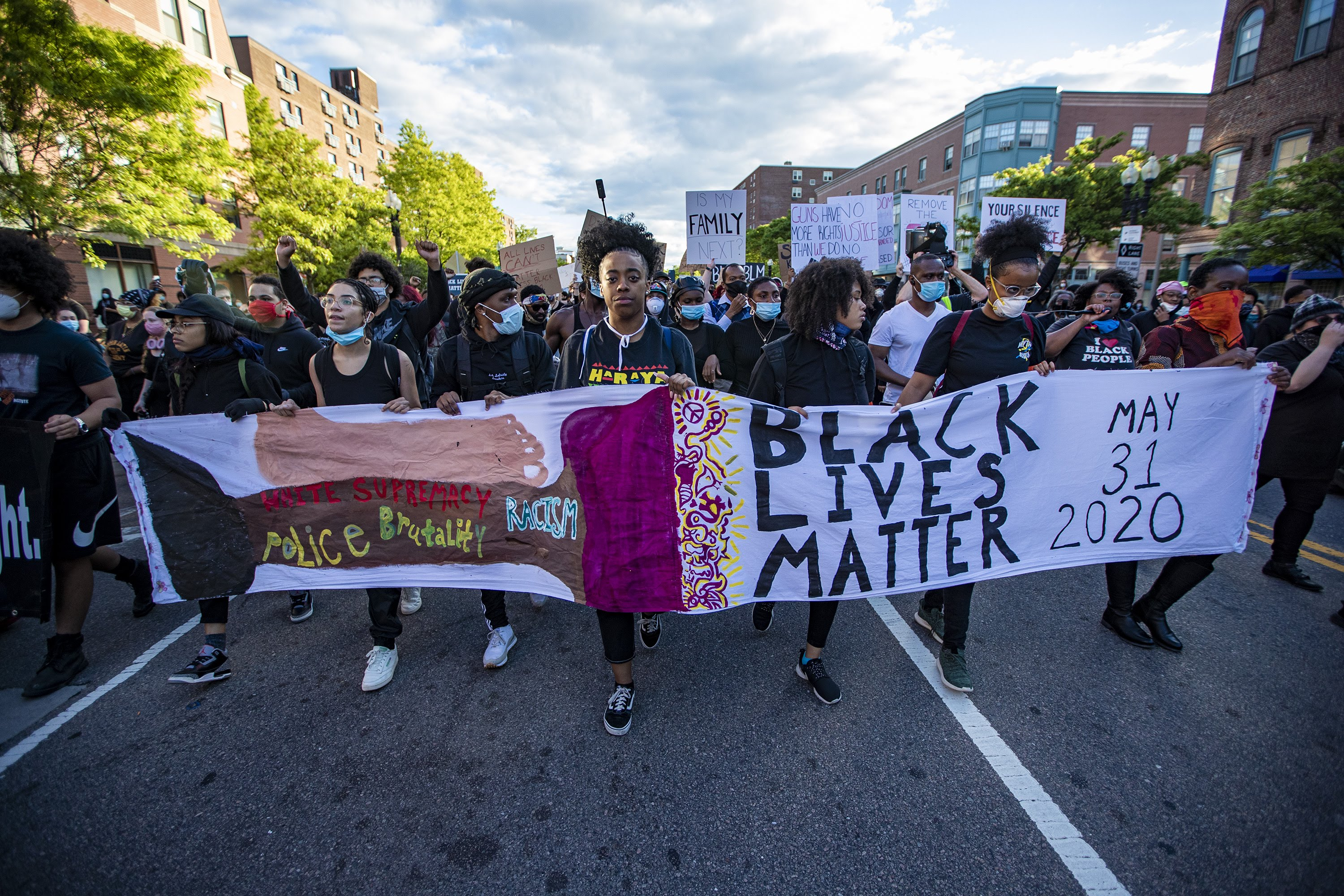 Thousands of protesters march up Washington Street on their way to rally at the Massachusetts State House. (Jesse Costa/WBUR)